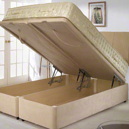 Two single beds combined into a double bed with four bed hinges.