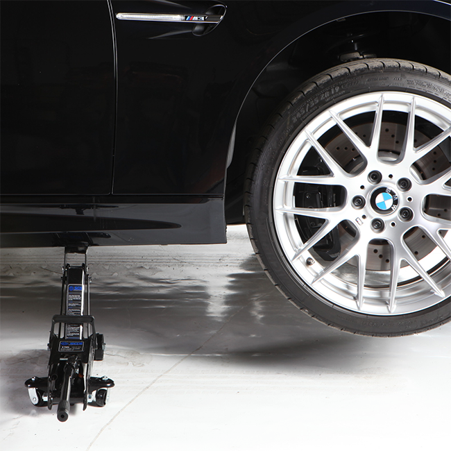 Powerful 2 ton jack easily lifts your car for wheel changes