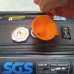 Using a different funnel, place it in the fuel tank hole, and gently pour in fuel till about 3/4 full.
